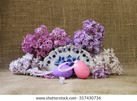 Easter still life with lilac flowers and decorative eggs. Easter card. - stock photo