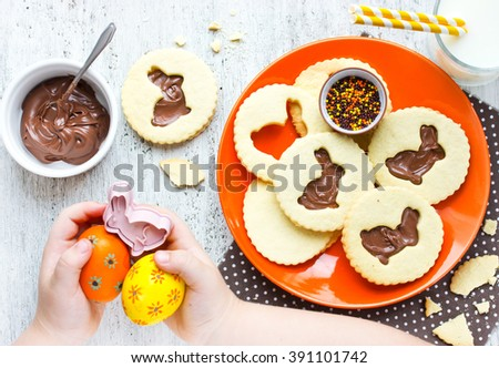 Easter sweet cookies for children and colorful eggs. Holiday food concept idea for kids - stock photo