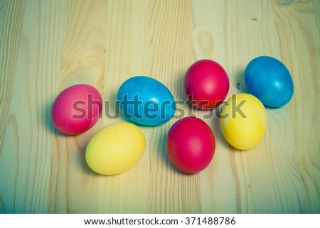 Easter symbols on wooden background. Toned.