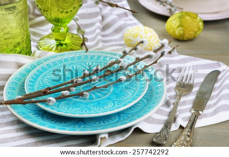 Easter table setting on color wooden background - stock photo