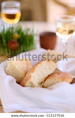 Easter table setting with eggs, wine and decoration