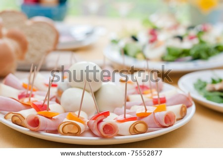 Easter table setting with freshly picked spring daffodils - stock photo
