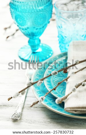 Easter table setting with pussy willow branches on color wooden background - stock photo