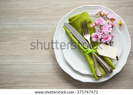 Easter table setting with spring flowers and cutlery. Holidays background - stock photo