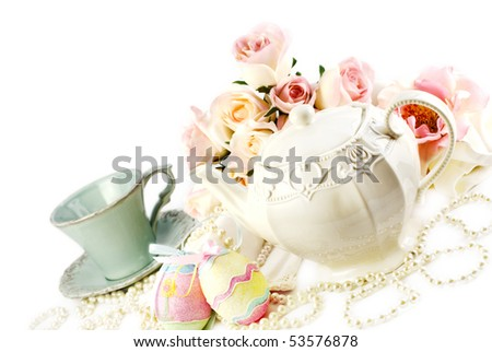 Easter tea set with teapot china cup and Easter decorations  diagonal with copy space - stock photo