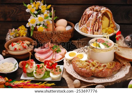 easter traditional polish dishes on rural wooden table - stock photo