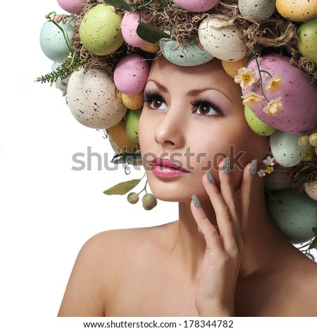 Easter Woman. Spring Girl with Fashion Hairstyle. Portrait of Beautiful Model with Colorful Eggs. - stock photo