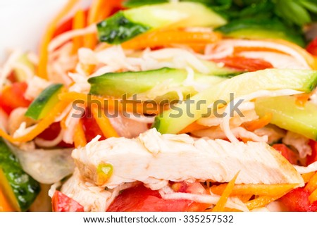 Eastern chicken salad with grated carrot and fresh vegetable mix. Macro. Photo can be used as a whole background. - stock photo