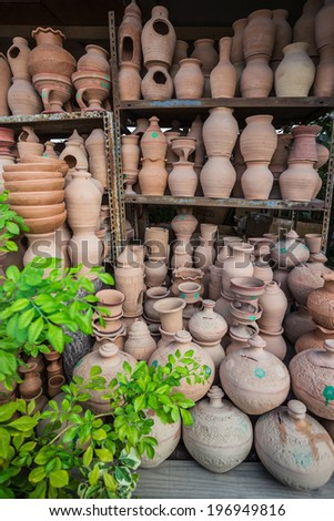 Eastern pitchers stand on a shelf in an Arab shop