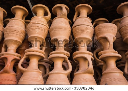 Eastern pitchers stand on a shelf in an Arab shop - stock photo