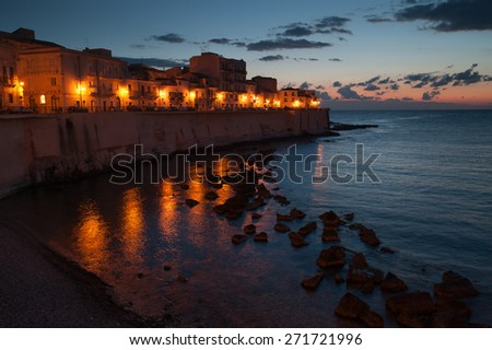 Eastern side of old Syracuse by night before the dawn - stock photo