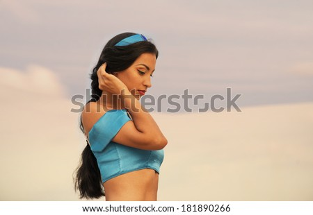 Eastern style portrait of a beautiful girl in belly dance costume - stock photo