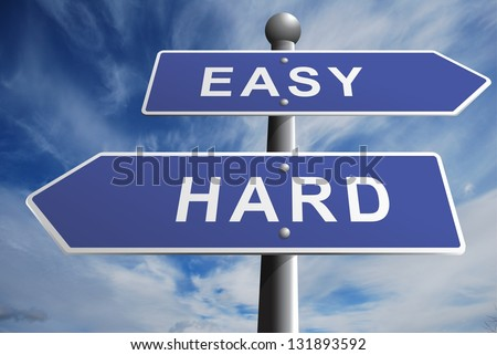 Easy Hard road directional sign with a wispy cloud background - stock photo