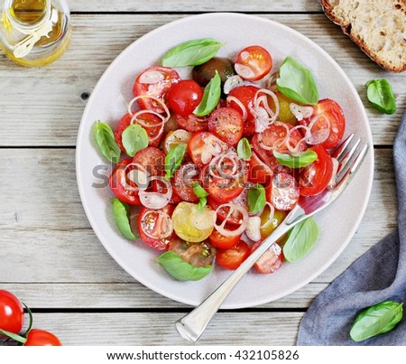 Easy summer tomatoes salad with basil and shallot. Concept of healthy eating.Selective focus - stock photo