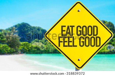 Eat Good Feel Good sign with beach background - stock photo