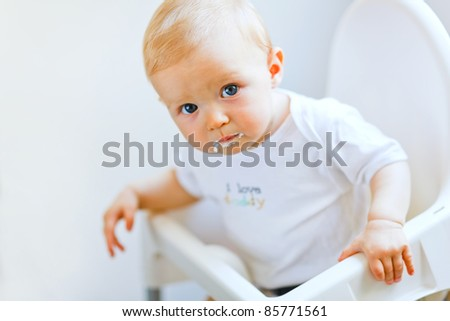 Eat smeared pretty baby girl in baby chair eating
