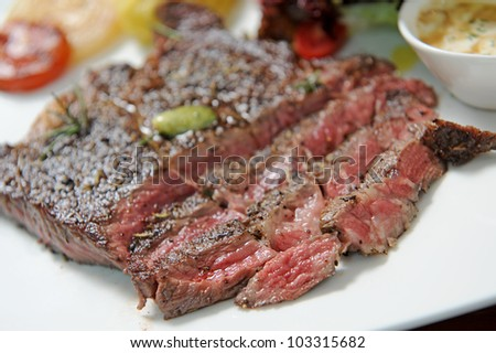 Eating a steak - stock photo