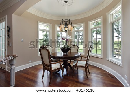 Eating area in luxury home with golf course view - stock photo