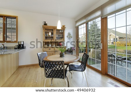 Eating area in suburban home with doors to patio - stock photo