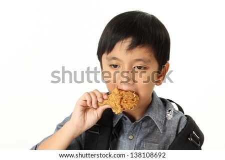Eating Chicken/child eating a chicken leg on white background