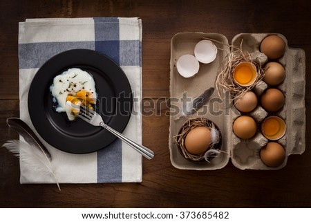 eating fried eggs flat lay still life rustic with food stylish raw ingredient poultry healthy cholesterol protein vitamin natural rustic low key - stock photo