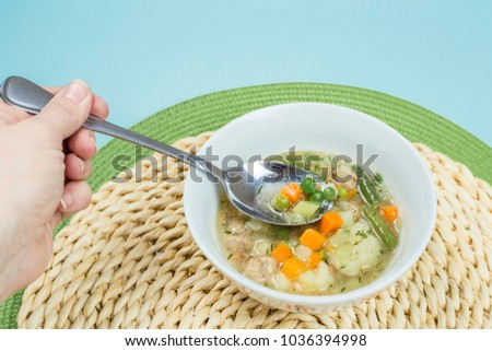Eating low calories vegetable soup from a white bowl. Hand holding a spoon with soup  sc 1 st  Shutterstock & Eating Low Calories Vegetable Soup White Stock Photo (100% Legal ...