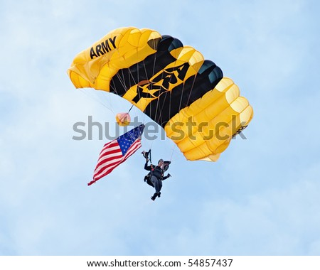 EAU CLAIRE, WI - JUNE 6: A closeup of a member of the U.S. Army Golden Knights parachute team on her descent with a United States flag at the Chippewa Valley Airshow in Eau Claire, WI on June 6, 2010. - stock photo