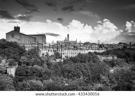 eautiful panoramic view of the historic city center of Siena at sunset with an amazing cloudscape on an idyllic summer evening, Tuscany, Italy - stock photo