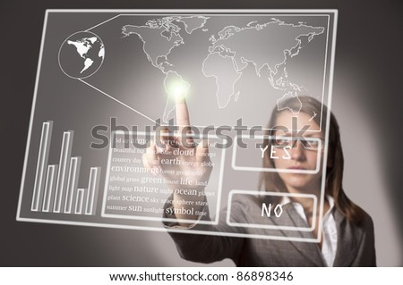 eautiful woman touches the touch screen on which there is a map of the world - stock photo