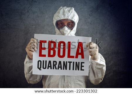 Ebola Quarantine sign held by medical health care worker wearing protective gown, gloves, mask and goggles. - stock photo
