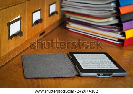 Ebook Reader in Library Stock Photo - stock photo
