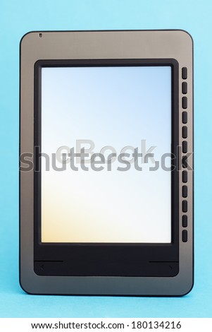 Ebook reader on a blue background - stock photo