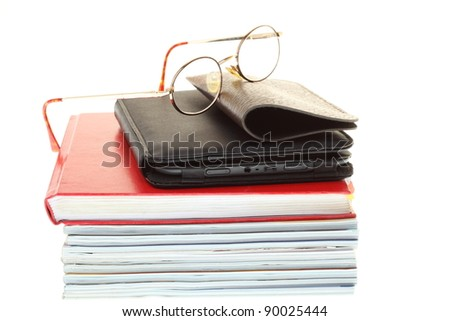 eBook reader pile of books, isolated on white - stock photo