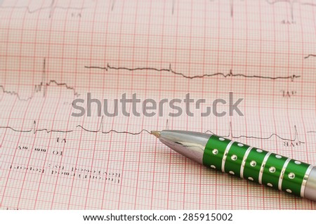ecg graph, electrocardiogram ekg and pen - stock photo