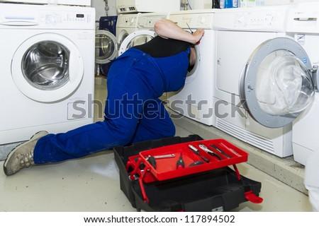 echnician repairing a washing machine