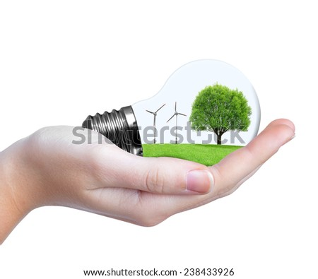 Eco bulb with wind turbines and tree in hand. Green energy concept.  - stock photo