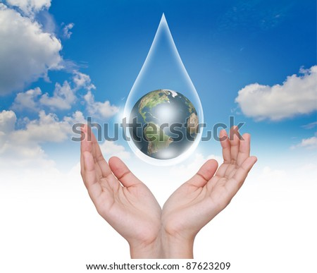 Eco concept : Hand with earth in water drop - stock photo