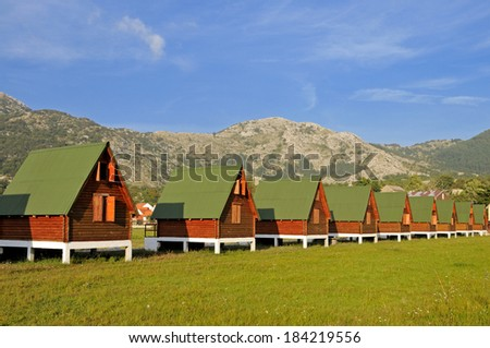 Eco cottages in the row  - stock photo