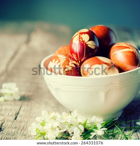 Eco Decor. Easter Eggs Decorated with Natural Fresh Leaves and Boiled in Onions Peels. Toned - stock photo