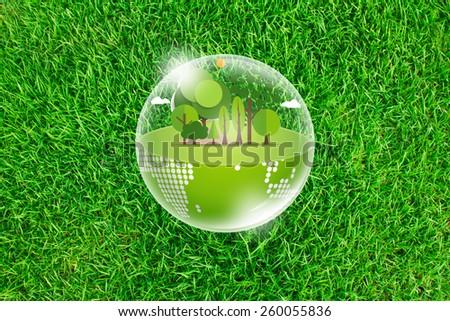 Eco Earth on Fresh spring green grass - stock photo