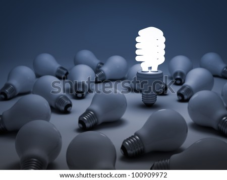 Eco energy saving light bulb, one glowing compact fluorescent light bulb standing out from the unlit incandescent light bulbs or Individuality concept - stock photo
