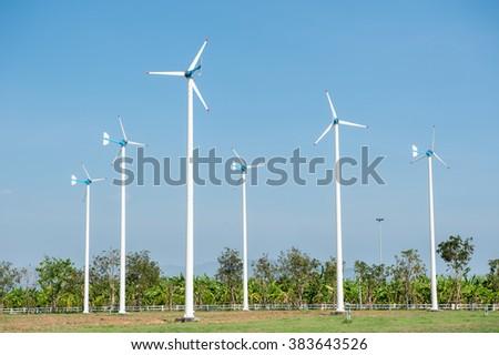 Eco energy - wind turbines ,blue sky background - stock photo