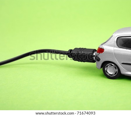 Eco-friendly car isolated on green background - stock photo