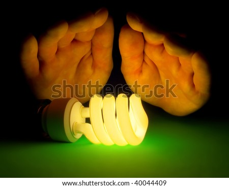 Eco friendly fluorescent lamp concept - stock photo
