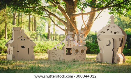 Eco-friendly toys made of cardboard ship, a house and a spaceship. Summer day. Eco concept - stock photo