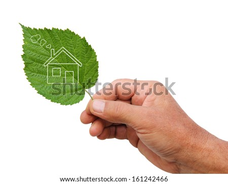 Eco house concept, hand holding eco house icon in nature  - stock photo