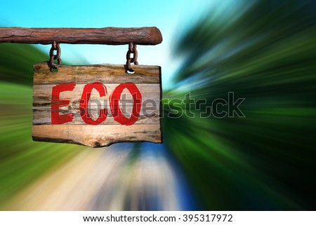 Eco motivational phrase sign on old wood with blurred background
