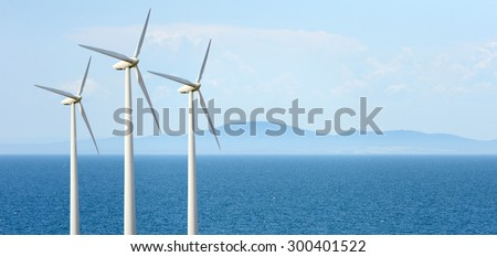 Eco power. Wind turbines generating electricity