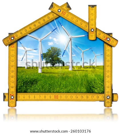 Ecologic House - Wind Energy Concept. Wooden yellow meter tool forming a ecologic house with wind energy turbine power station inside. Isolated on white background - stock photo