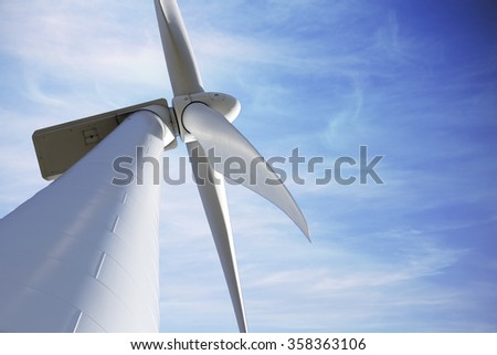 Ecological and renewable energy wind mill against sky with copyspace - stock photo